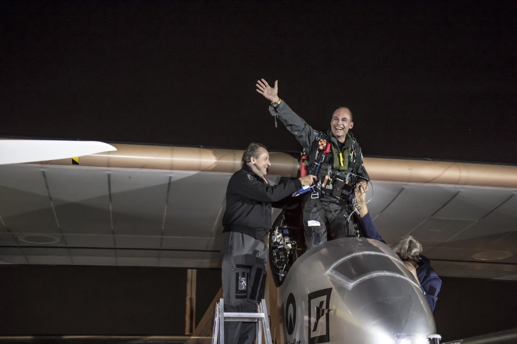 Borschberg celebrates with Piccard after landing Solar Impulse's HB-SIA prototype at Dulles International Airport